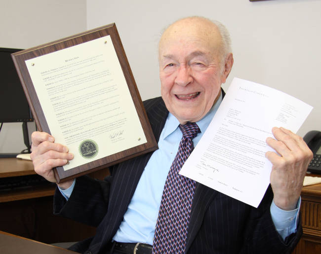 Bill Guerri displays his plaque and a nominating letter