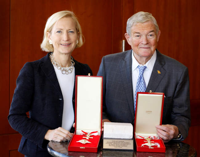 Linda Bond and Senator Bond with their Order of Malta honors