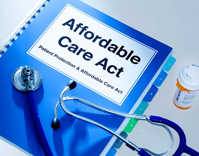 An Affordable Care Act booklet with stethascope