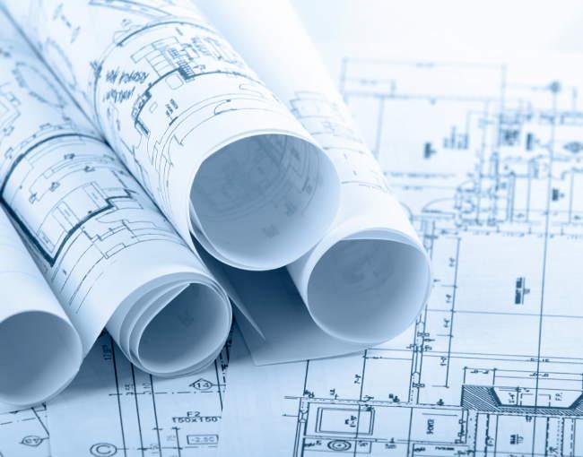 rolled-up blueprints