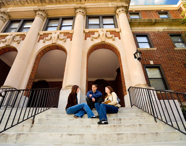 college campus - students sitting on steps