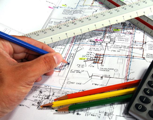 construction blueprints with hand