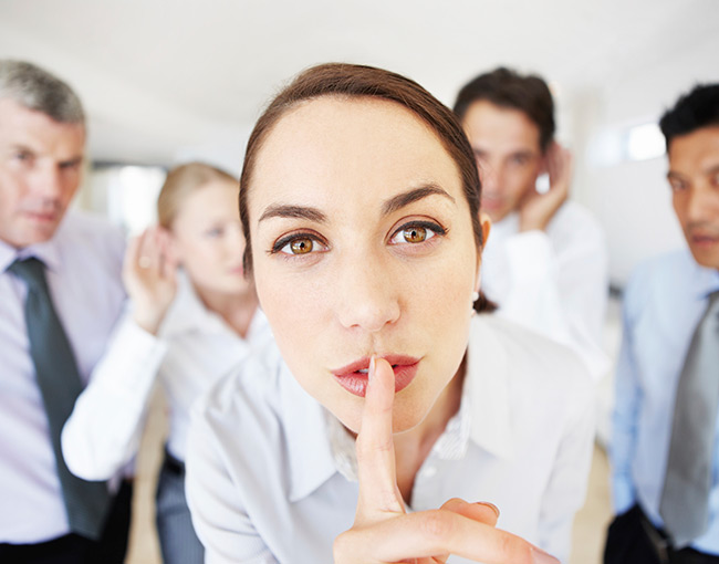 woman whispering secret