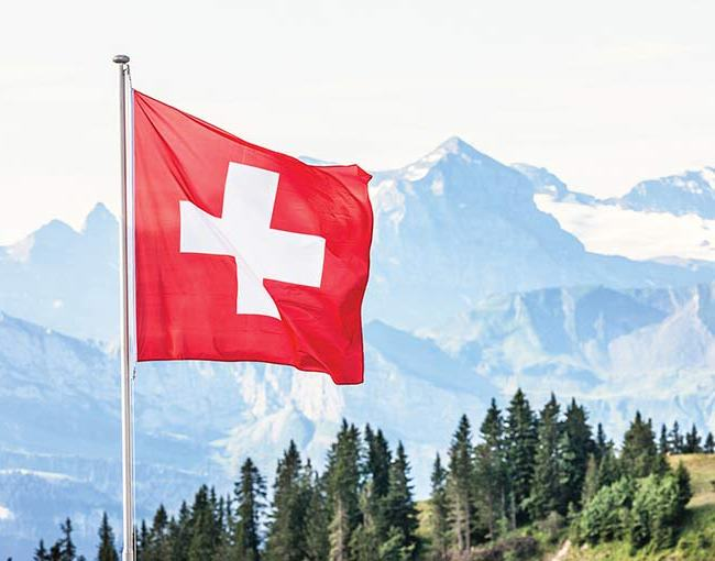 Swiss flag with mountains