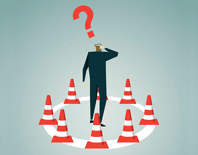 illustration of a confused businessman trapped by construction cones
