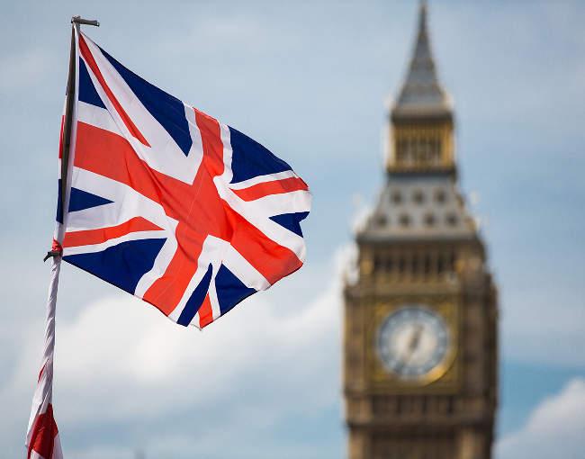 U.K. flag with Big Ben in background