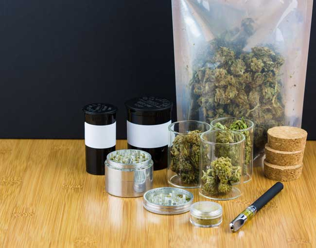 Cannabis products in plastic bag and medical canisters