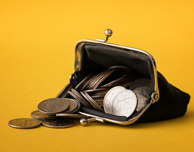An open coin purse full of quarters