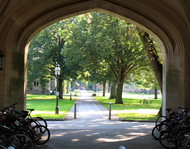 Archway on college campus with bikes