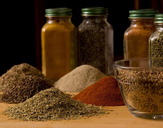 Spices in jars and in small piles
