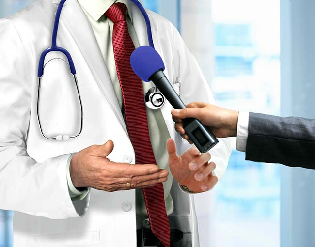 doctor-talking-to-microphone_18556352024_o