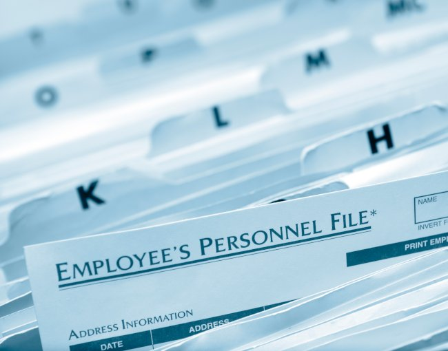 An employee personnel file sticking out of organised files