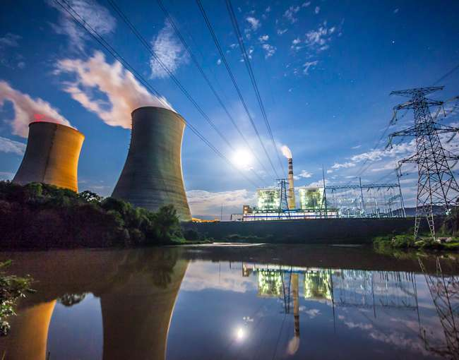 Nuclear cooling tours and energy plant next to a river