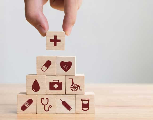 A pyramid of blocks featuring health care icons
