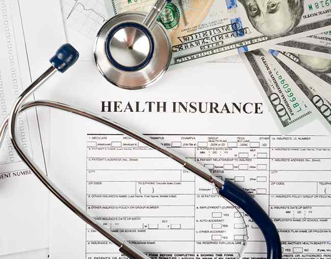Health insurance forms and stethoscope
