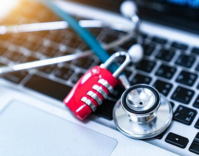 Stethoscope over a laptop computer keyboard