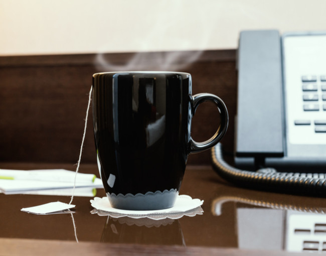 A mug of hot tea on a desk