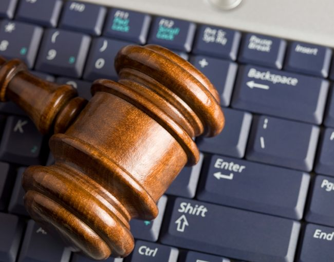 A gavel resting on a computer keyboard