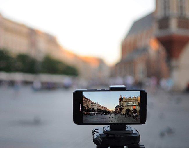 Smartphone on a tripod prepared to take a picture in a town sqare