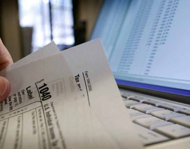 Preparing a 1040 tax form at a computer