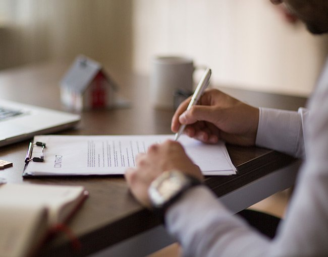 A person signing a real estate contract