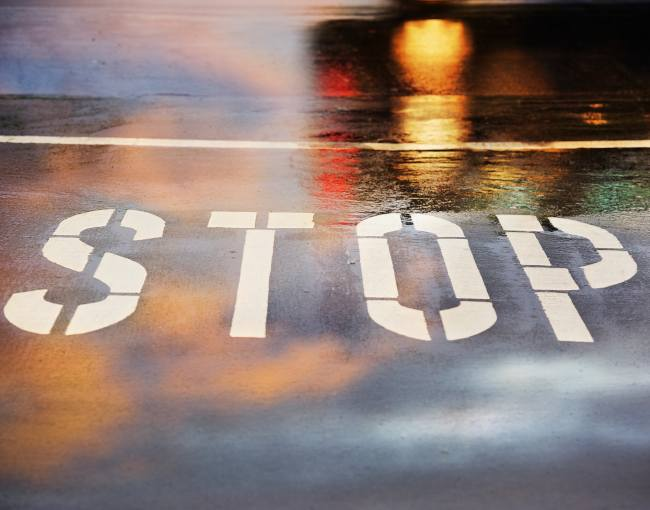 A stop line on a wet road