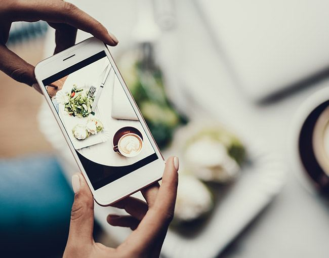 A smart phone taking a picture of food