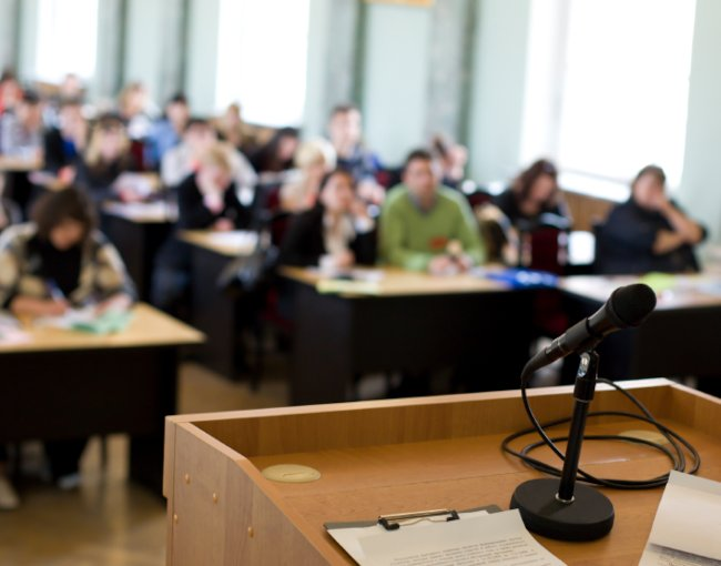 A podium and microphone at a speaking seminar