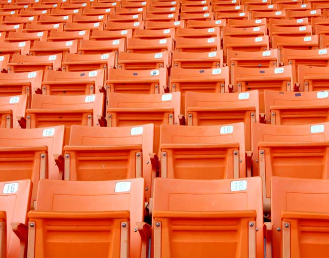 Rows of orange sports stadium seats