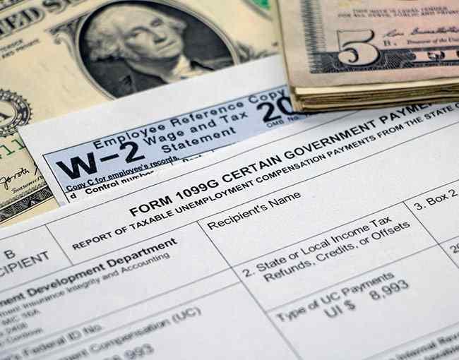 U.S. dollar bills, a W-2 form, and a 1099G form