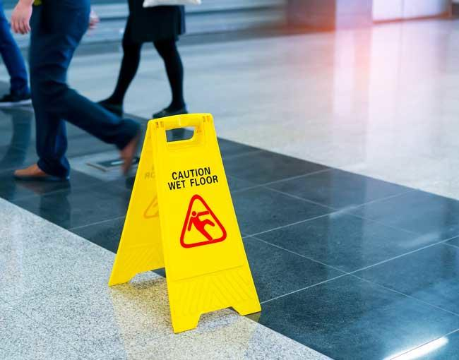 Wet floor sign on a tile floor