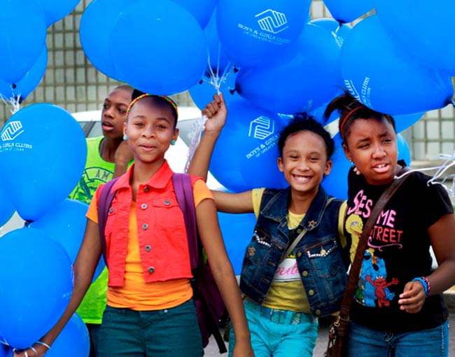 Children with balloons at the Boys and Girls Club announcement 2013