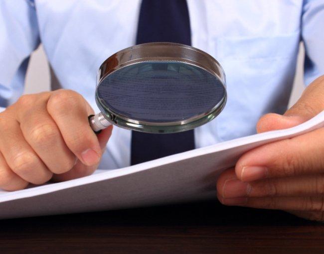 examining document iStock_89973131_650x450