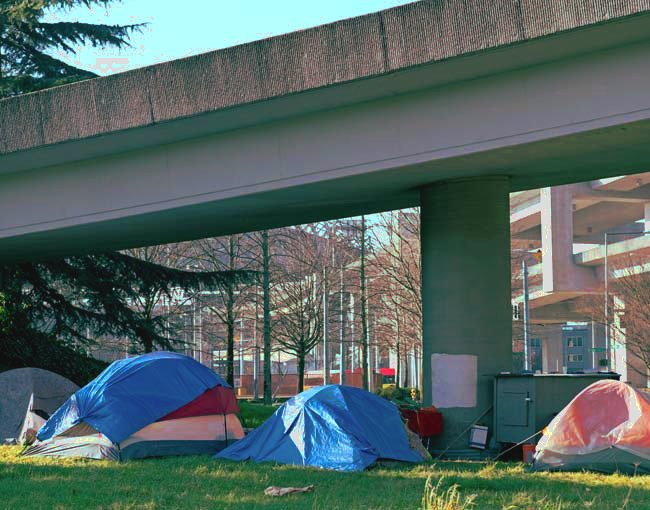 Tents below a highway ramp