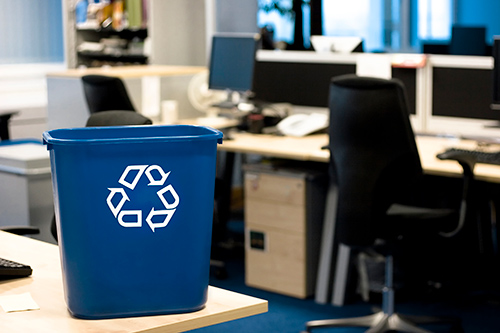 blue recycling bin on office desk