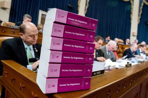 stack of tax regulation books in Congress