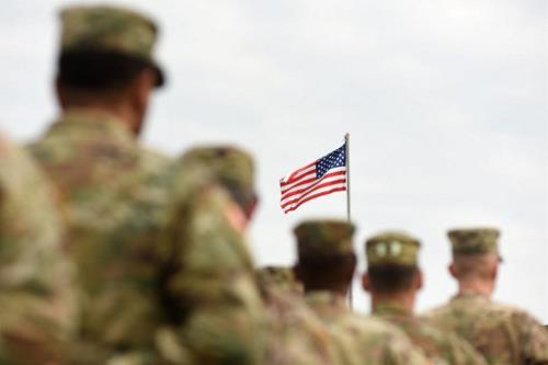 U.S. veterans facing the U.S. flag