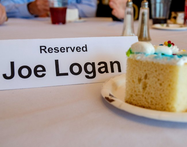 Joe Logan place card and slice of cake