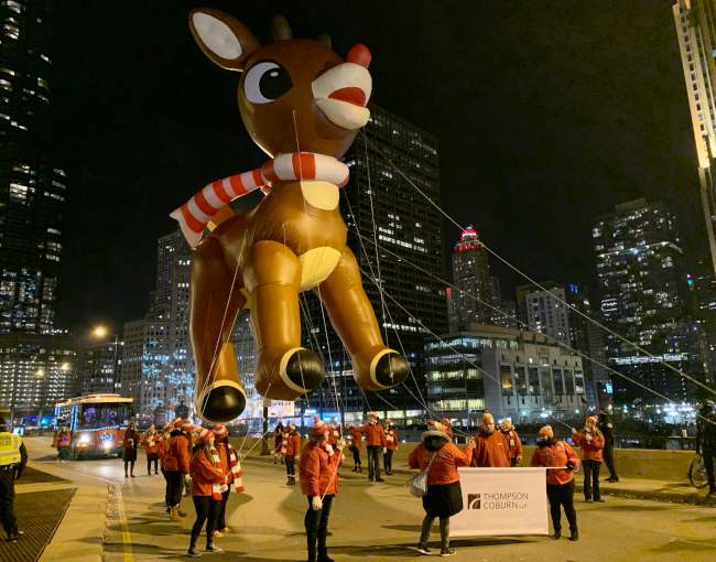 Thompson Coburn holding Rudolph parade balloon in downtown Chicago