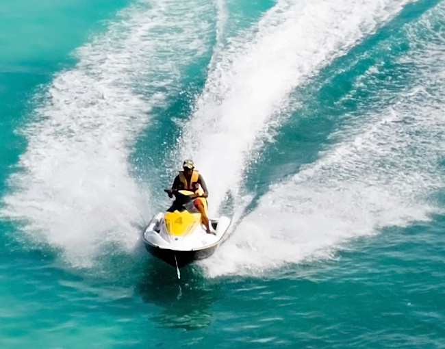 A man riding a jet ski in tropical waters