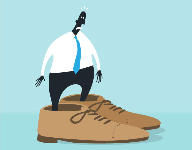 cartoon of person standing in too-large shoes