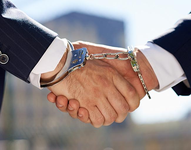 Handshake in handcuffs
