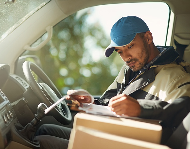 delivery driver checks on packages