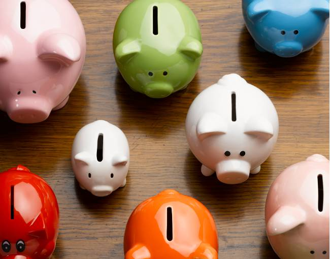 Overhead image of colorful piggy banks