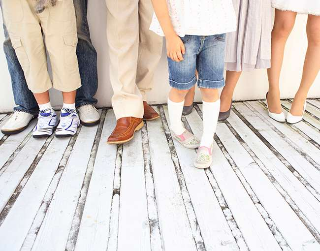 lower legs and shoes of a large family