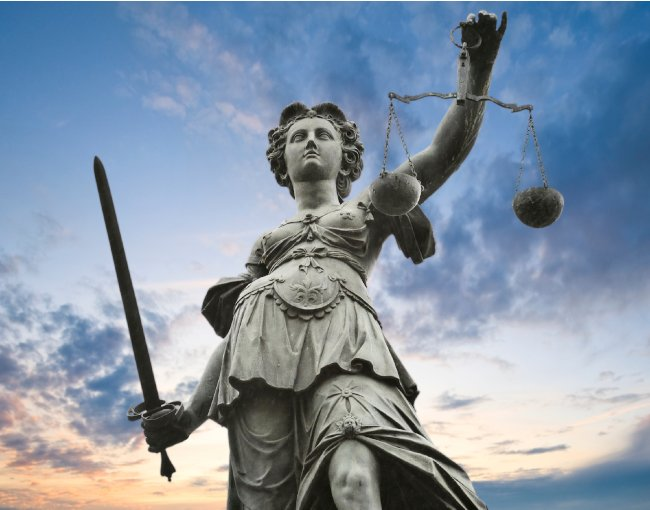 Statue of Lady Justice holding a sword and scale