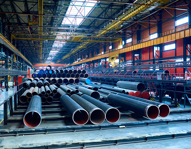warehouse filled with industrial pipes