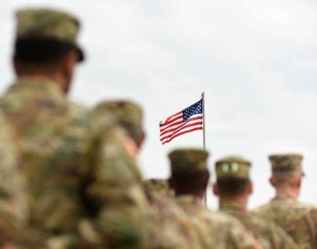 U.S. veterans saluting the U.S. flag