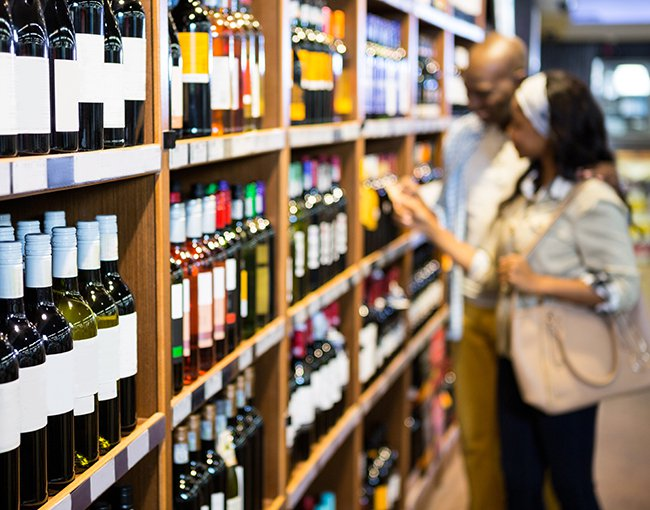 couple browsing wine at a wine shop